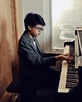 Joey Alexander at a rehearsal studio in New York, NY. Sept. 25, 2016  Credit: Ryan Pfluger for TIME