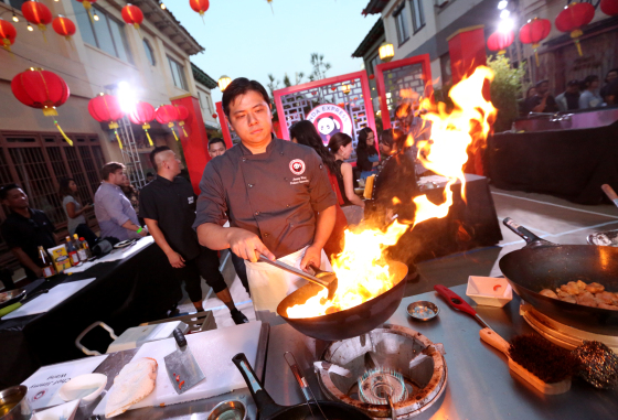 IMAGE DISTRIBUTED FOR PANDA RESTAURANT GROUP - Chef Jimmy Wang prepares Panda Express' General Tso's Chicken at Chinatown Summer Nights on Saturday, Aug. 20, 2016, in Los Angeles. (Photo by Casey Rodgers/Invision for Panda Restaurant Group/AP Images)