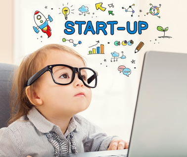 Startup concept with toddler girl using her laptop