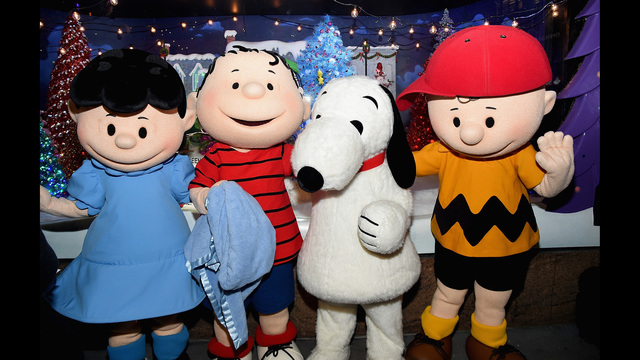 "NEW YORK, NY - NOVEMBER 20:  The Peanuts pose in front of a Peanuts inspired Christmas window at the Macy's Presents ""It's The Great Window Unveiling, Charlie Brown"" at Macy's Herald Square on November 20, 2015 in New York City.  (Photo by Jamie McCarthy/Getty Images)"